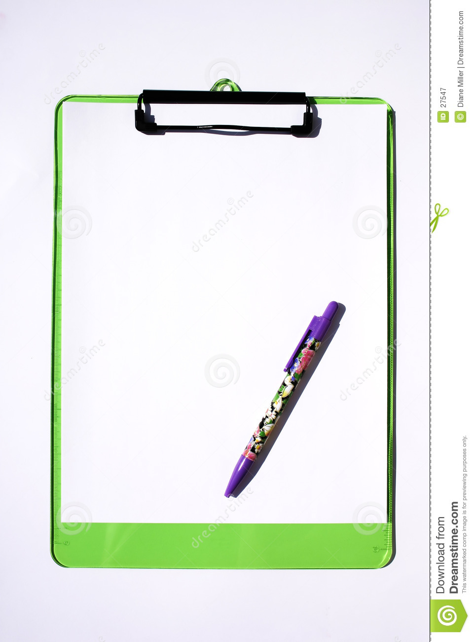 Bright green transparent clip board with floral-printed pen on white ...