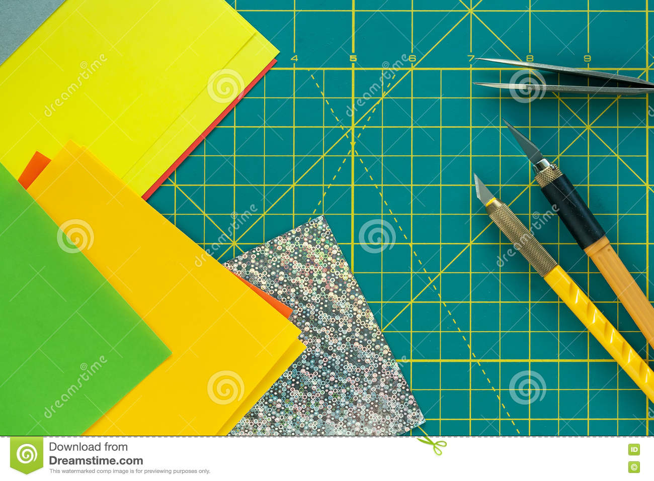 Green Cutting Mat With Art Knives Tweezers And Paper Crafts Stock