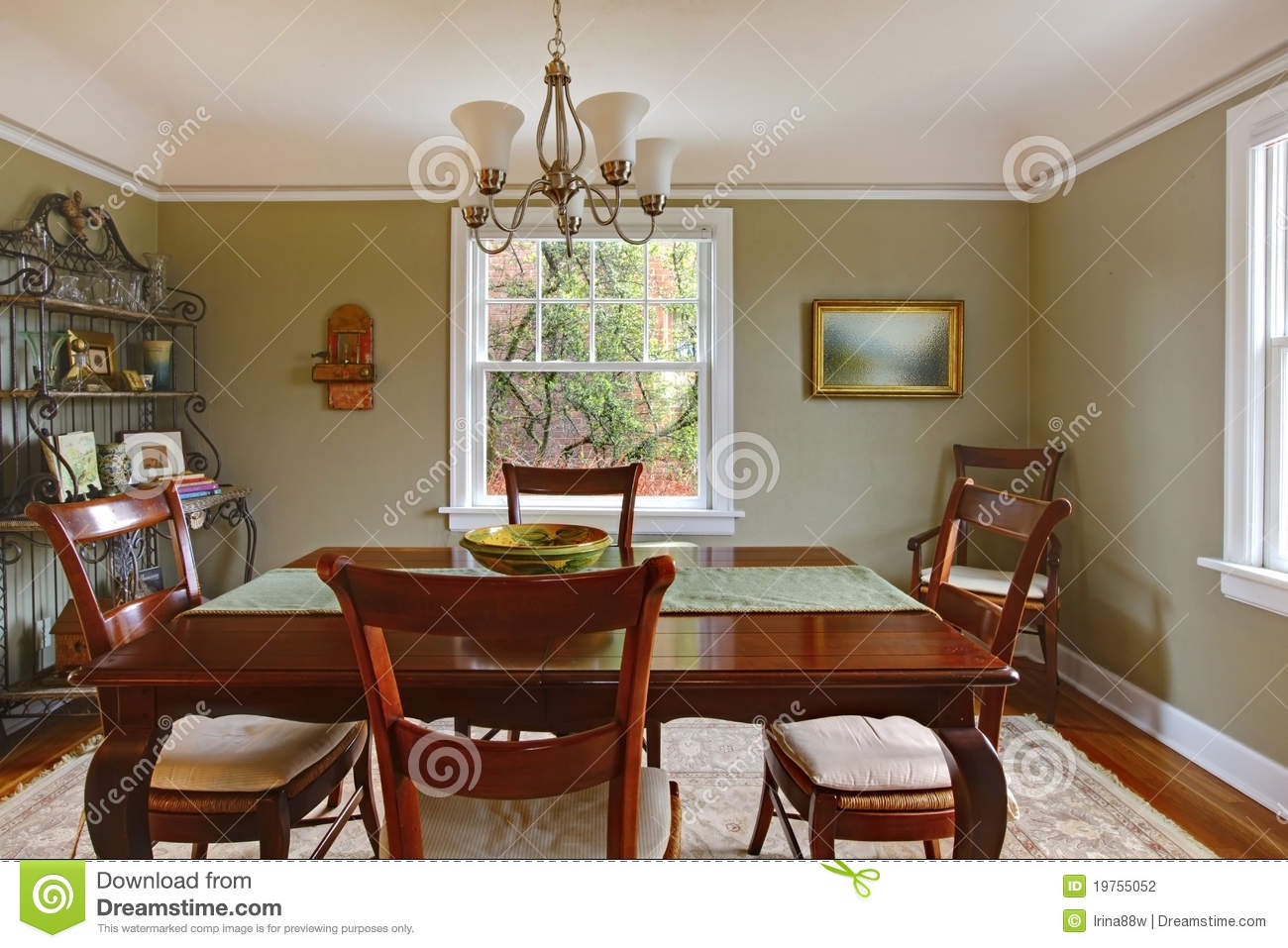 Green Dining Room With Mahogany Furniture Stock