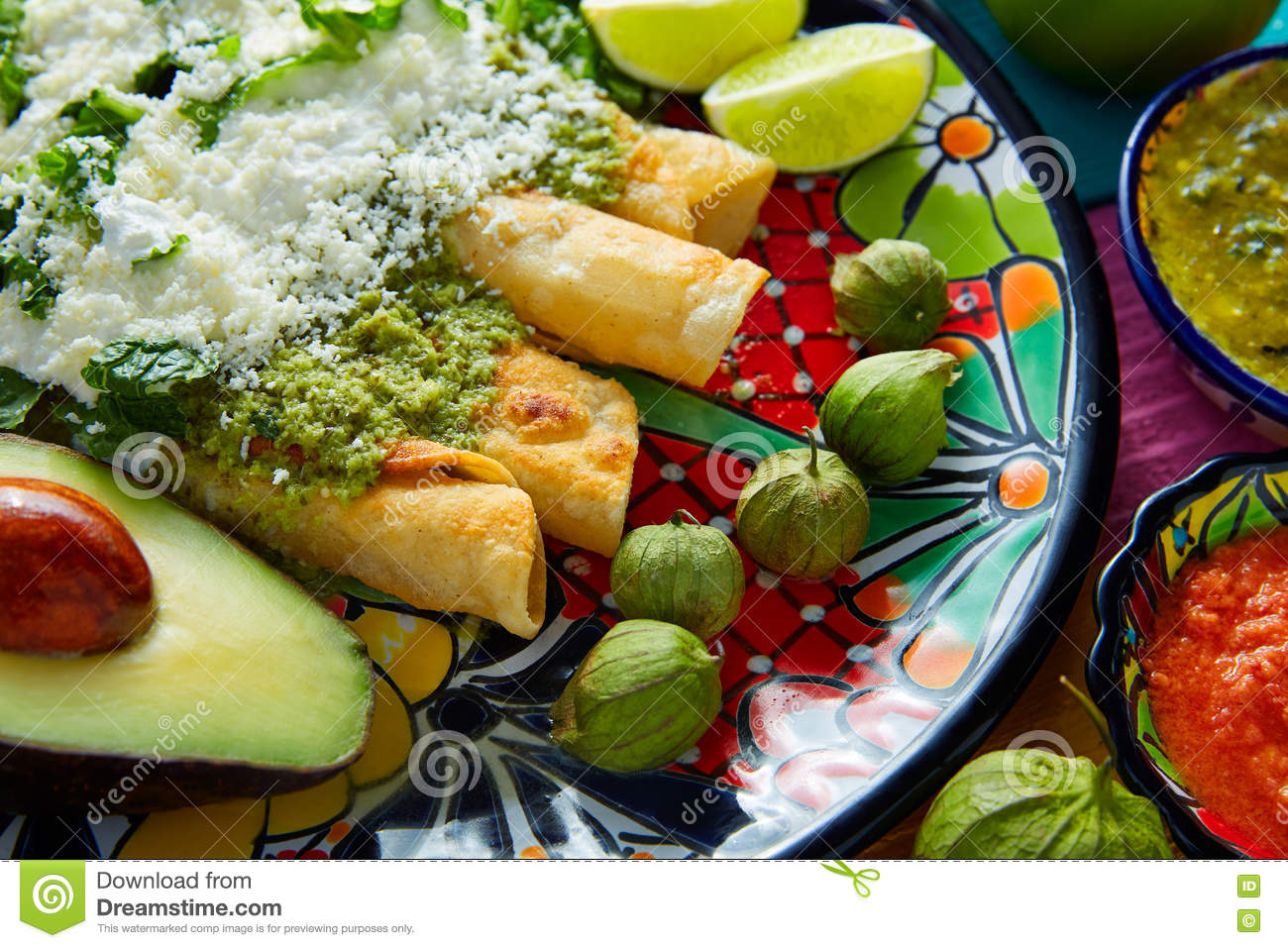 Green enchiladas mexican food with guacamole royalty free for Cuisine on the green