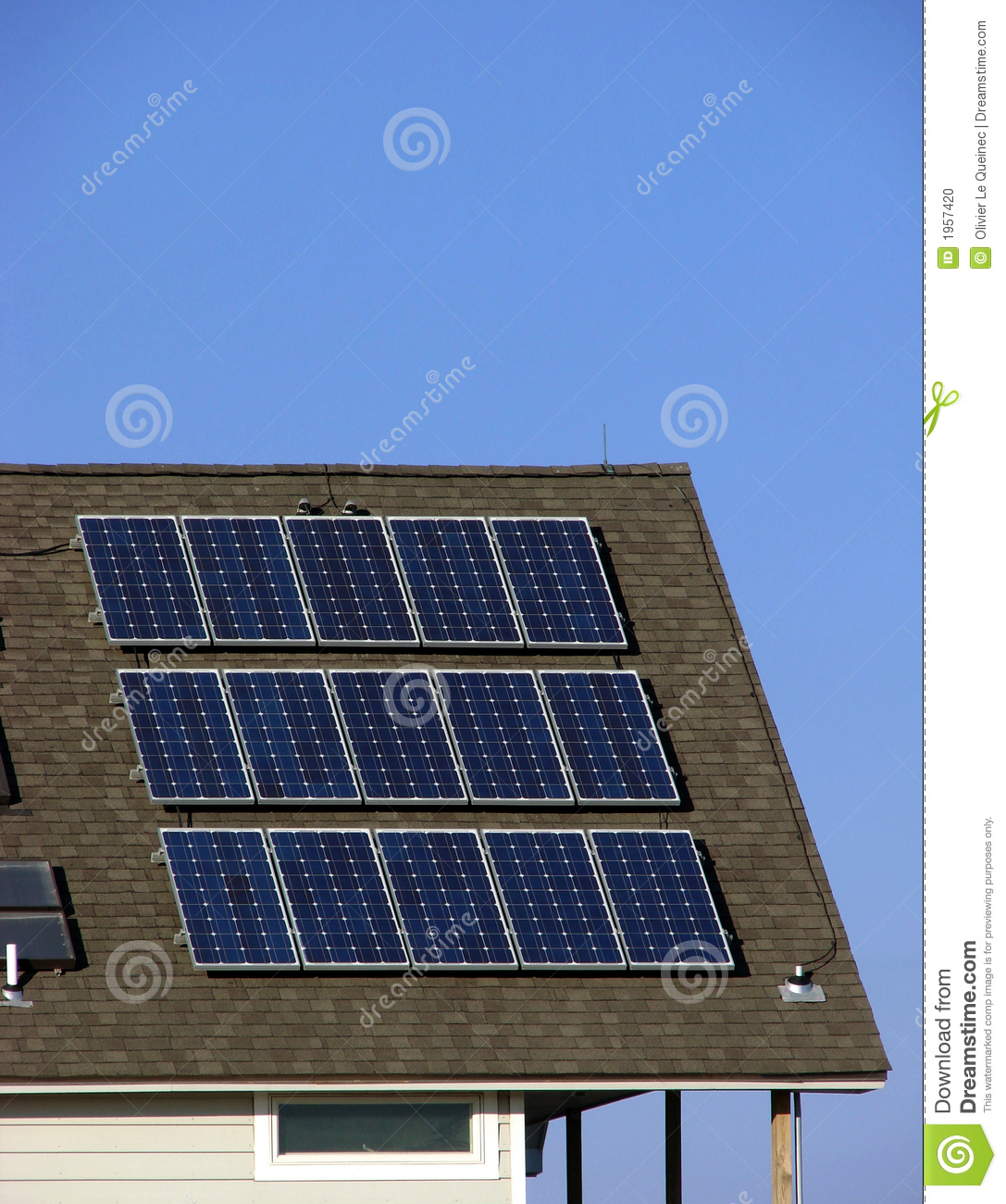 Solar Panel Yearly Savings: Green Energy Saving Solar Panels On Building Roof Stock