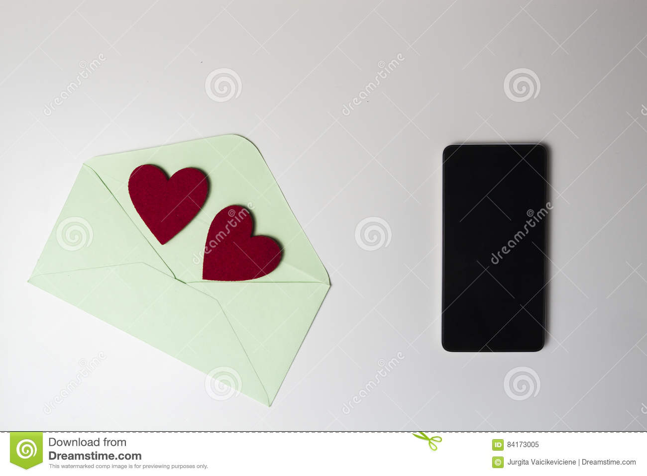 Green Envelope With Two Felt Red Hearts And Mobile Phone On White