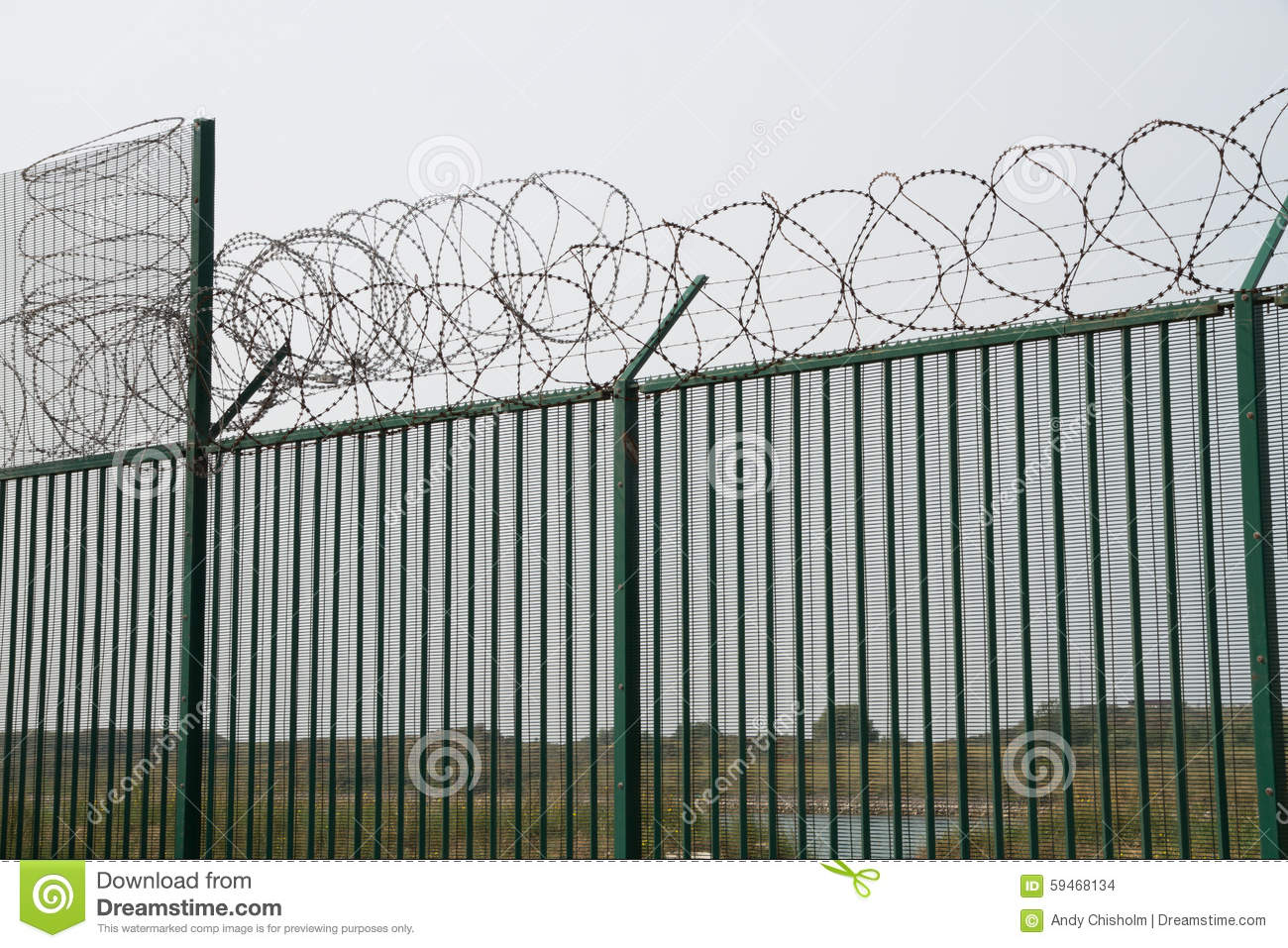 Green Fence With Razor Wire Guarding French Ferry Terminal. Stock ...