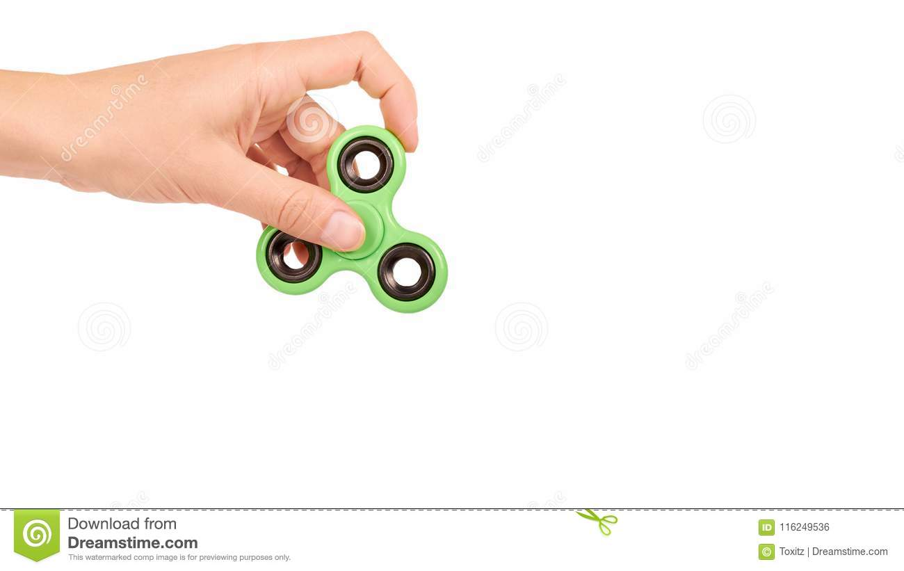 green fidget spinner in hand isolated on white background copy
