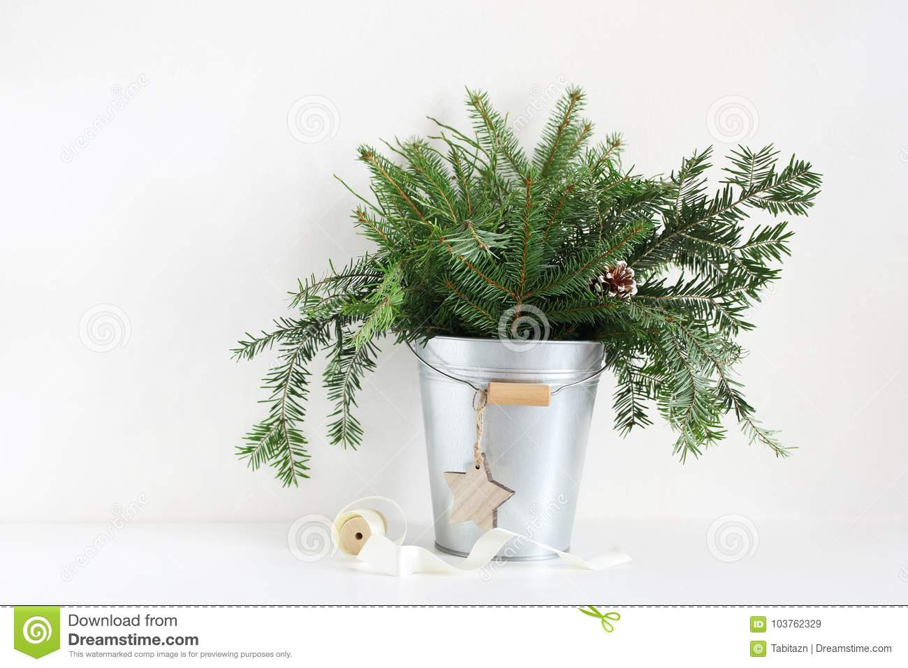 Download christmas tree in a galvanized bucket webdesigninusa