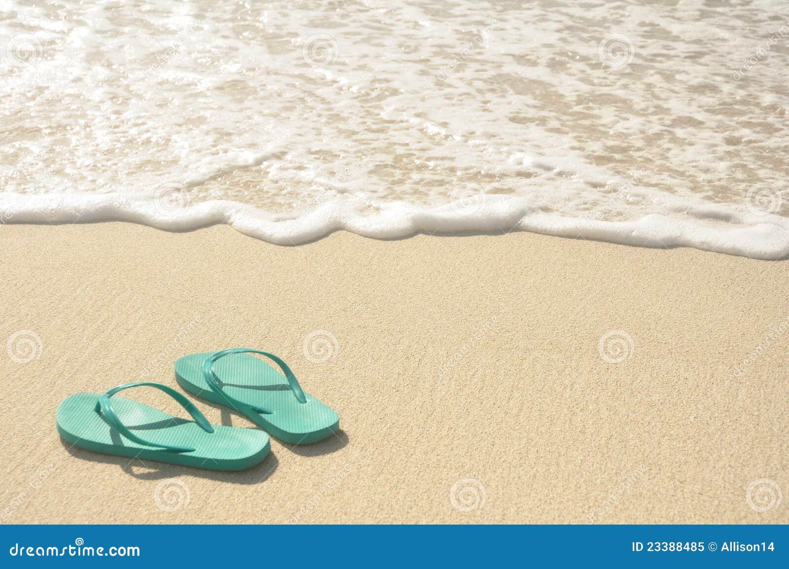 Green Flip Flops on Beach