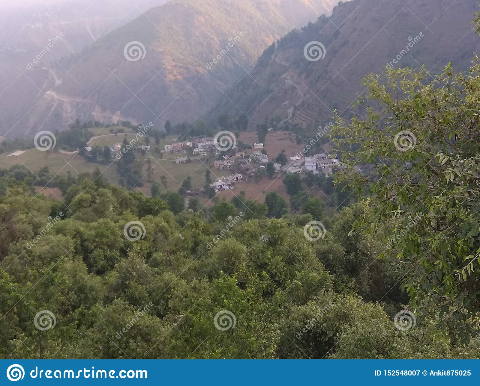 Green forest and hills with green nature with small village in mountain area