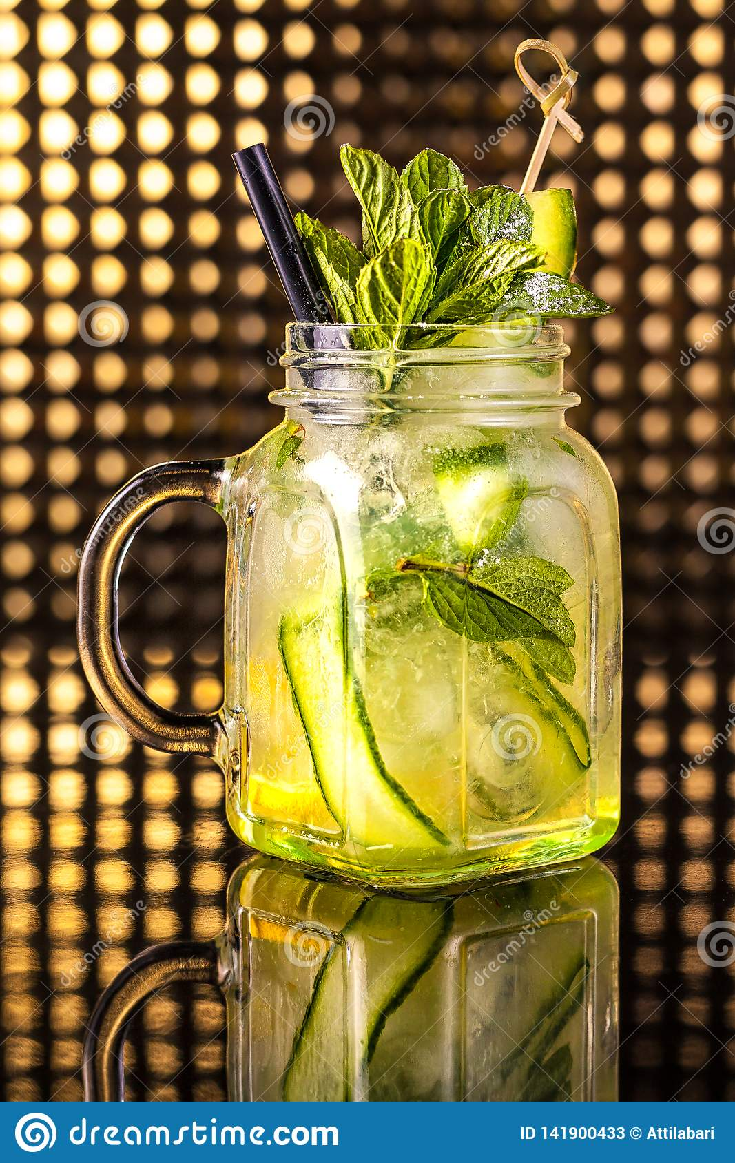Green fruit cocktail lemonade with fresh cucumber in vintage jar