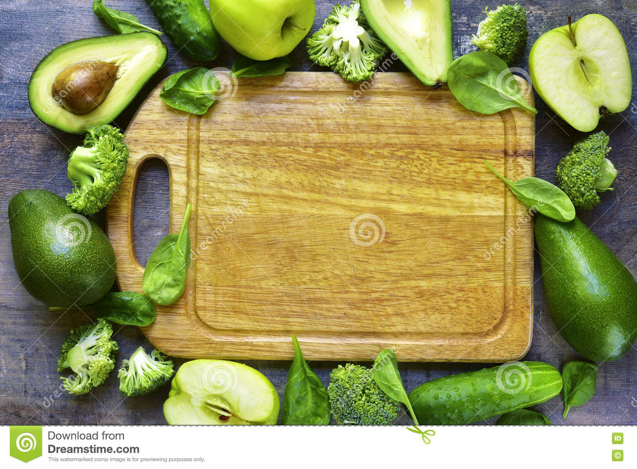 green fruits and vegetables with cutting board and knife stock