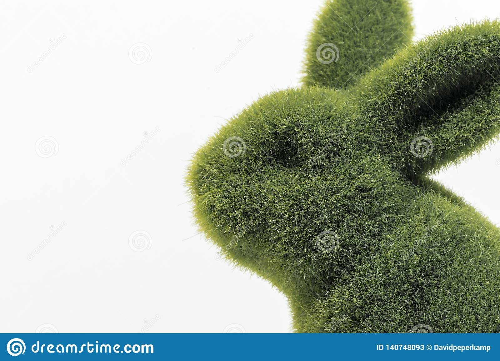 Green furry easter bunny`s close up