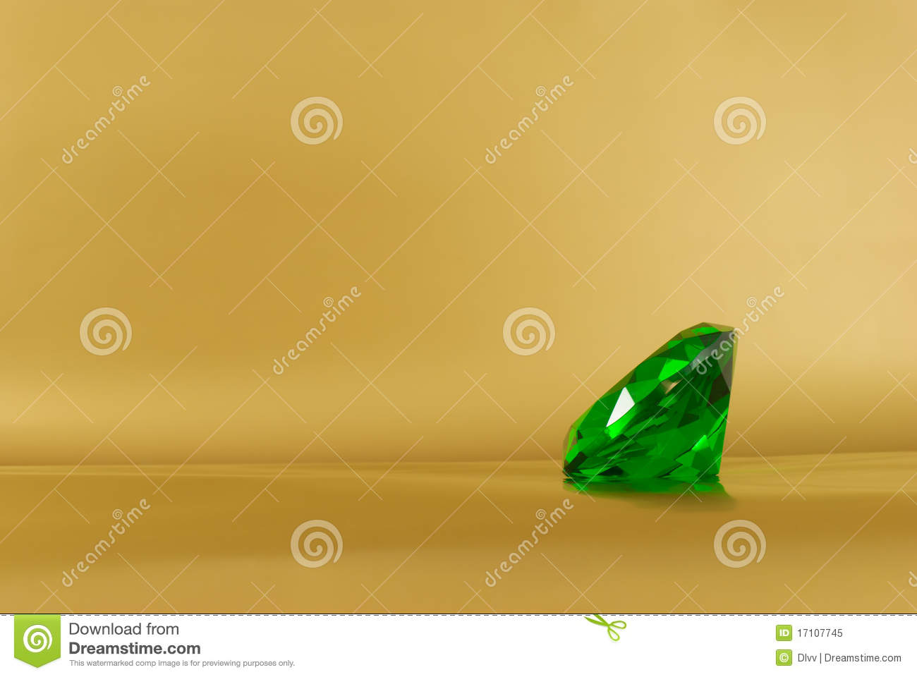 Green Emerald Gem On A Golden And Gold Background