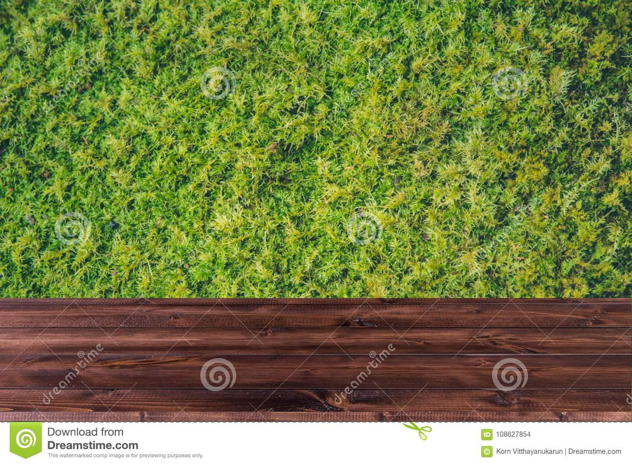 Green grass with wood table desk