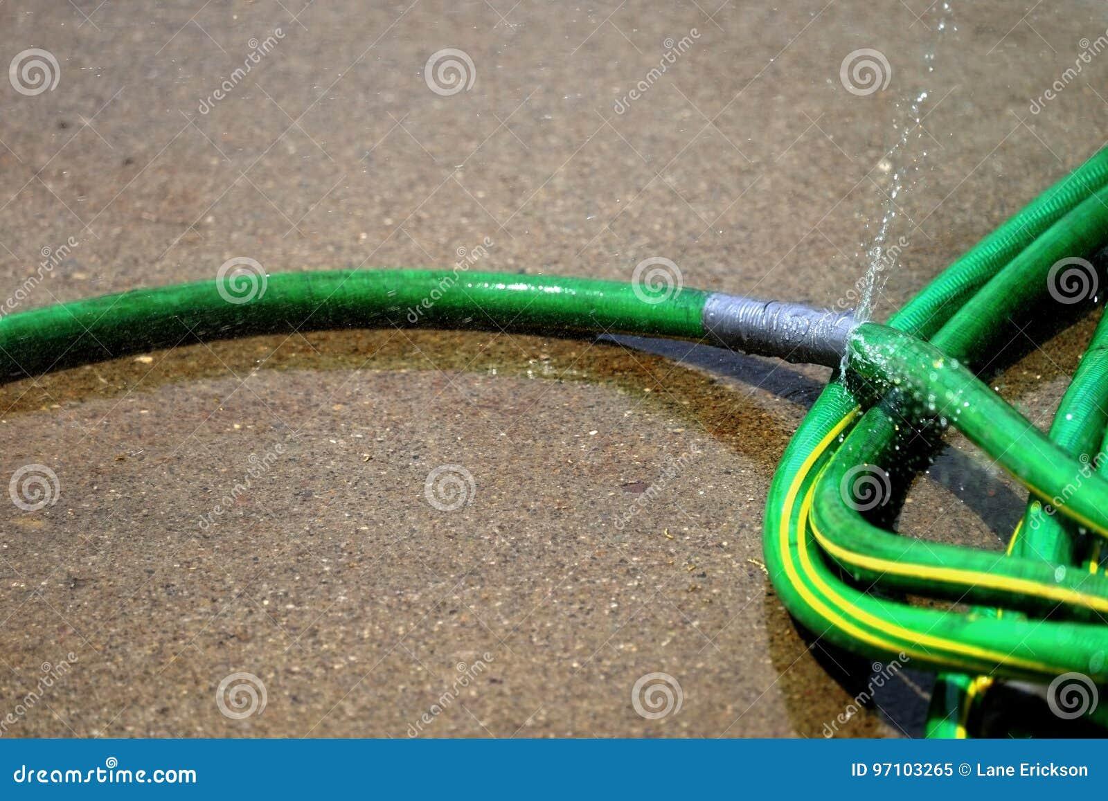 Green Hose Leaking Spraying Water Stock Image - Image of burst ...