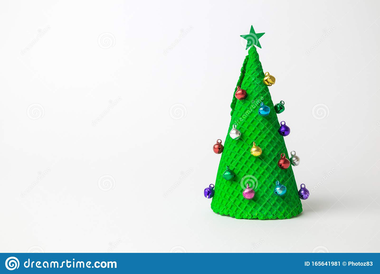 Green Ice Cream Cone In Form Of Christmas Tree Decorated With Colorful Baubles And Star On White Background Minimal Creative Stock Image Image Of Bright Baubles 165641981
