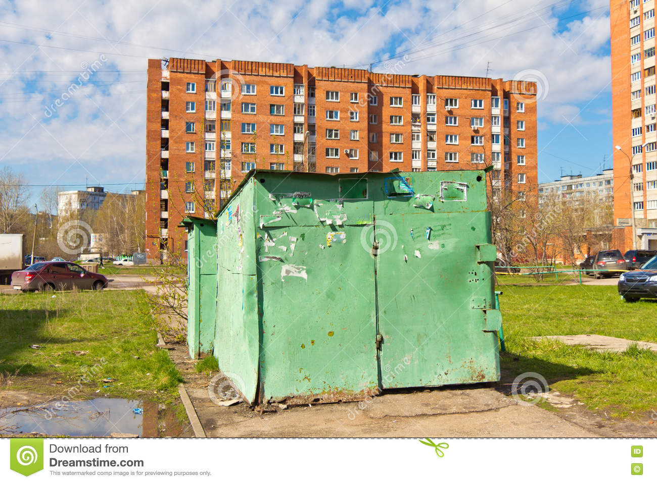 Green Iron Shed Stands On The Sidewalk Stock Photo - Image