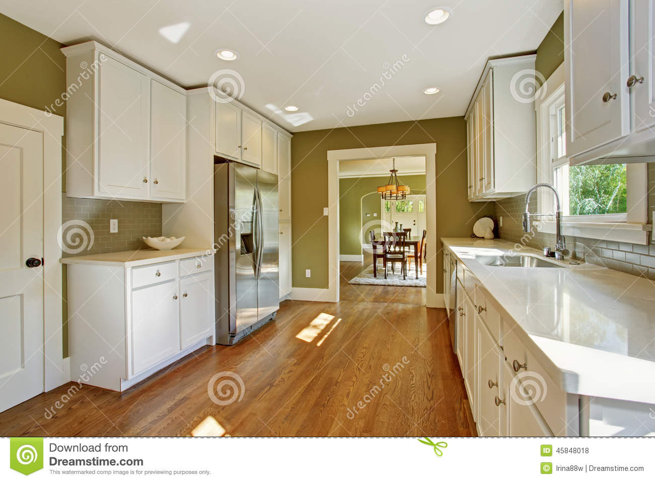 Green Kitchen Room With White Storage Combination Stock