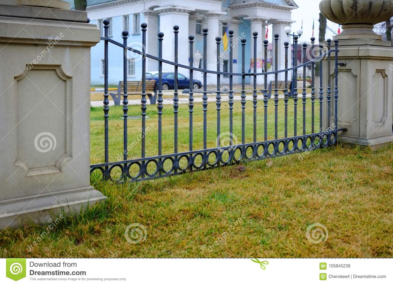 Picture of: Green Lawn In Front Of A Decorative Fence With Bars Background Beautiful Wrought Fence Image Of A Decorative Cast Iron Fence Stock Image Image Of Beautiful Bars 105845239