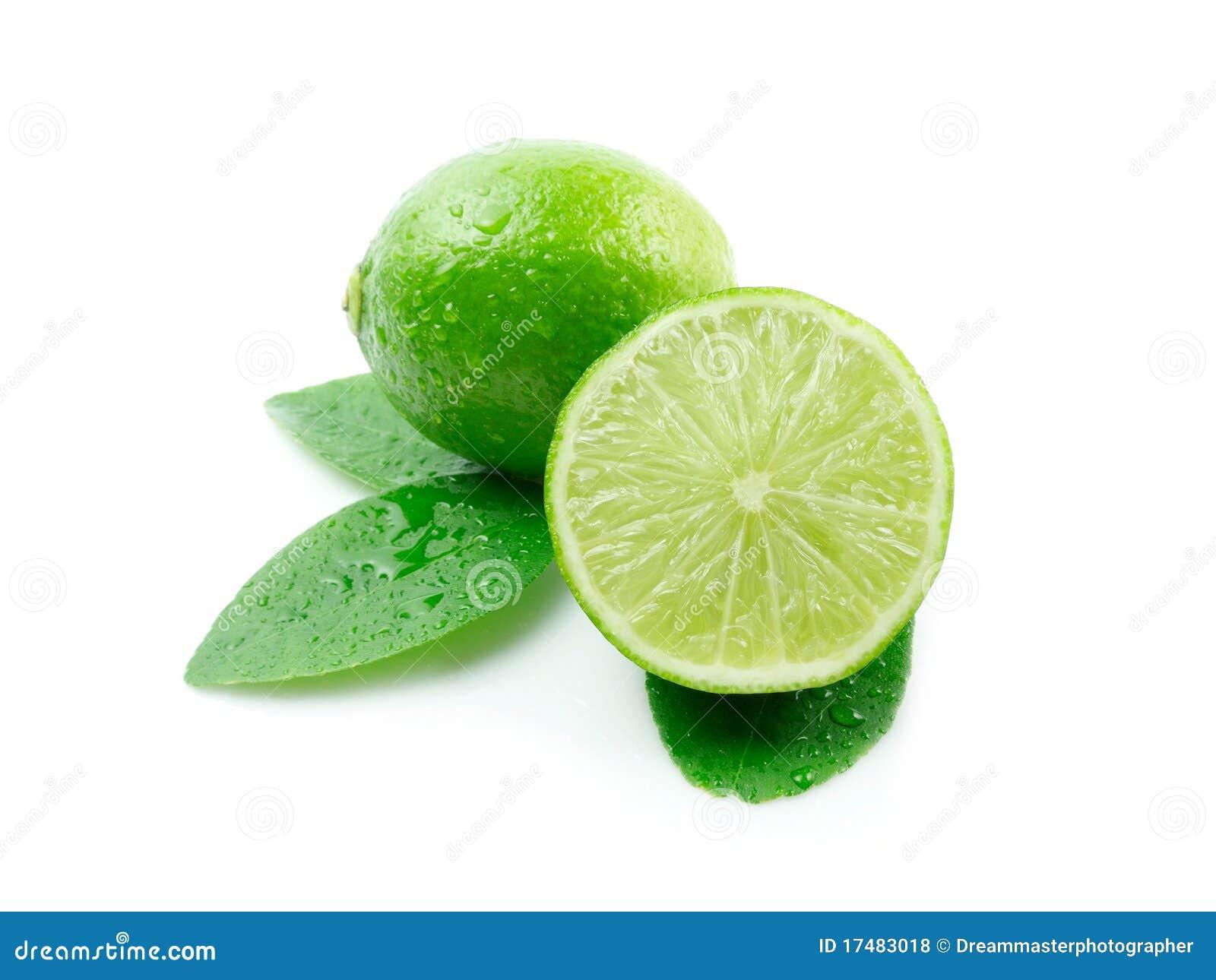 Green lemons with leaves