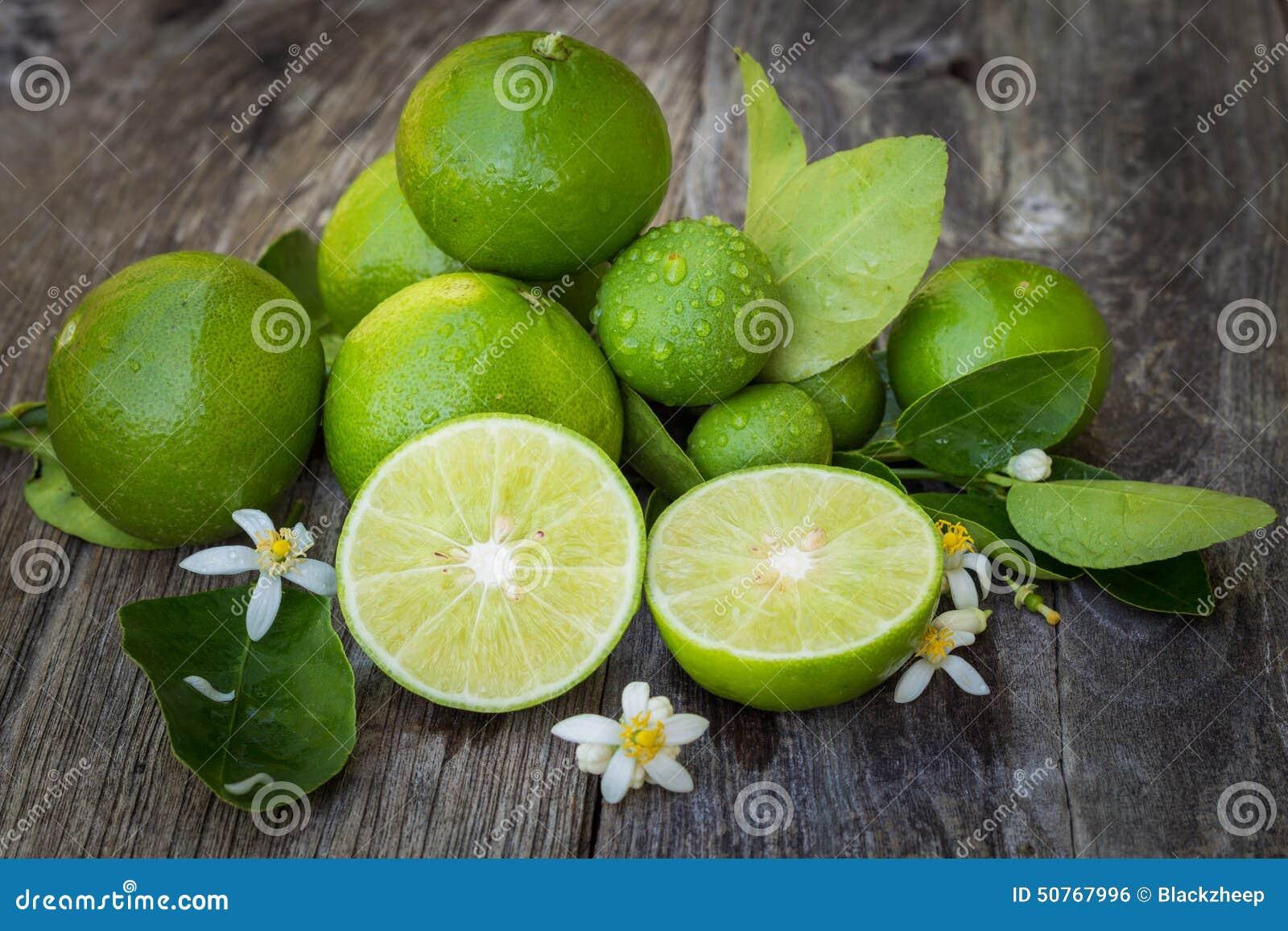 Green lime lemon on wood