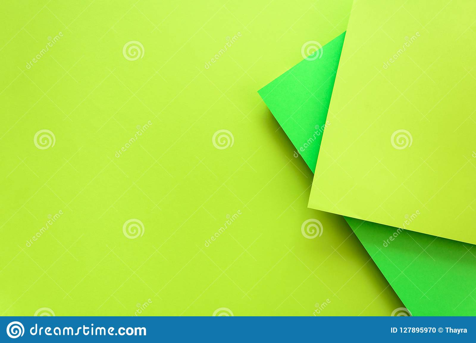 Green and lime pastel color papered background. Volume geometric flat lay. Top view. Copy space