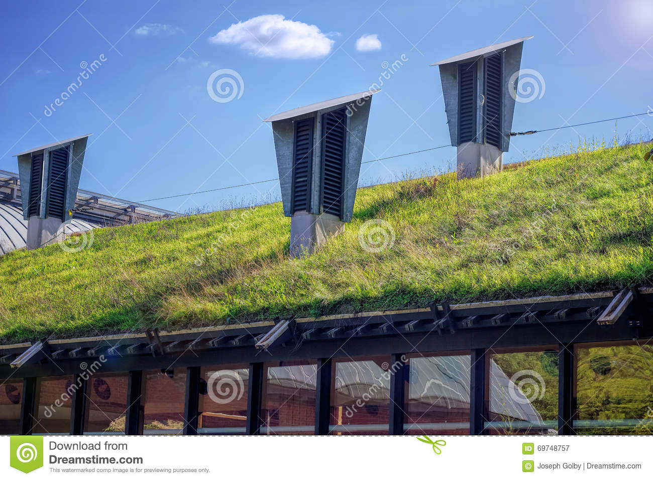 Green living roof eco friendly building stock image for Eco green builders