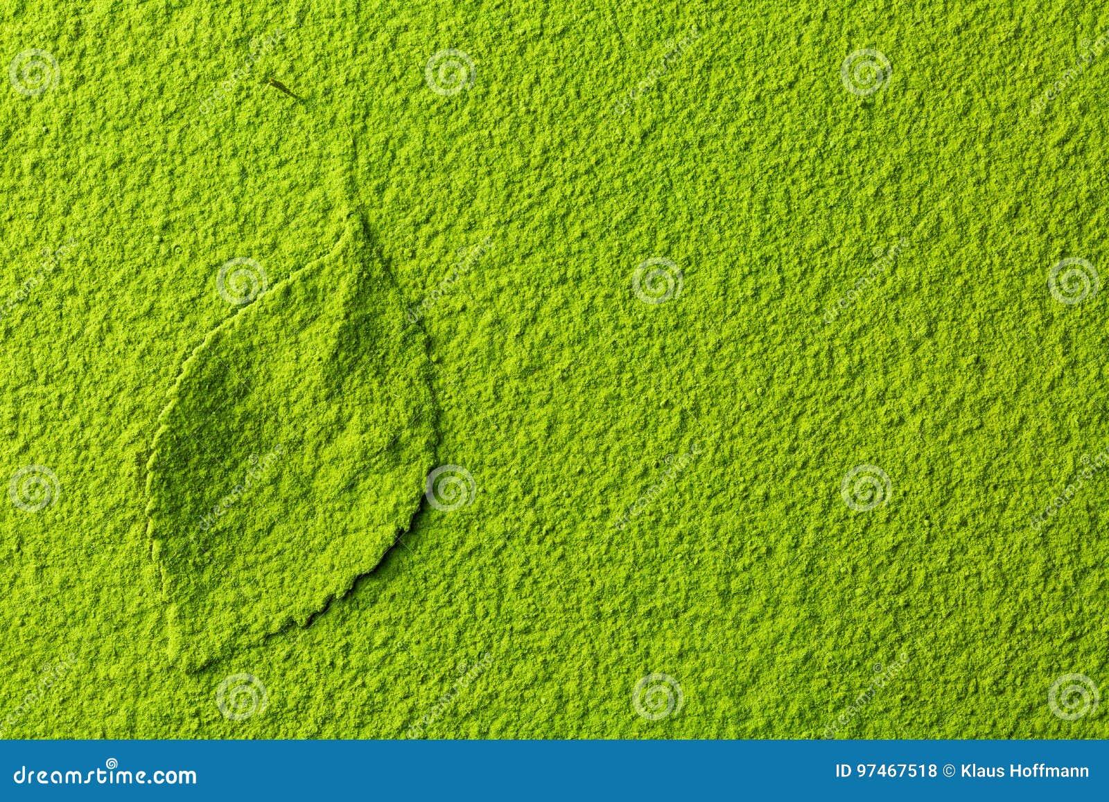 Green matcha tea powder with tea leaf