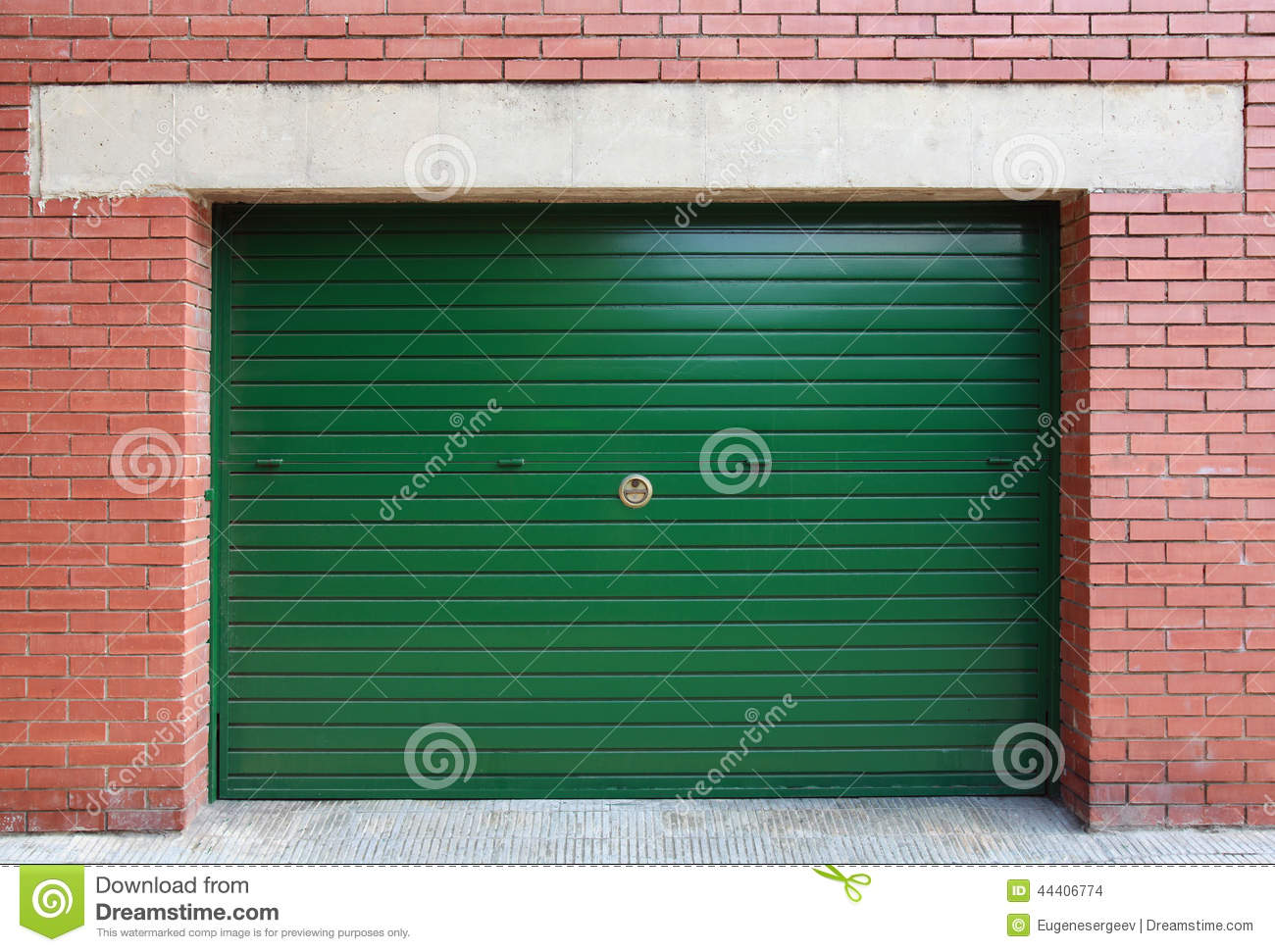 Green metal garage gate in red brick wall stock photo for Brick garages prices