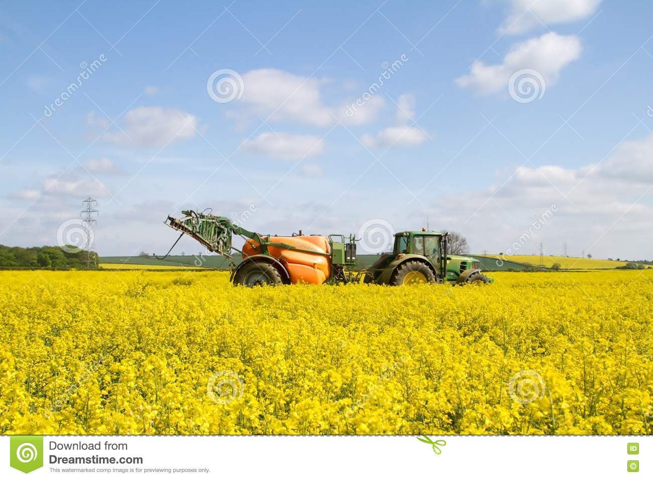 Green modern tractor pulling a crop sprayer editorial image image modern john deer tractor spraying oilseed in crop field yellow flowers blue sky with insecticide mightylinksfo