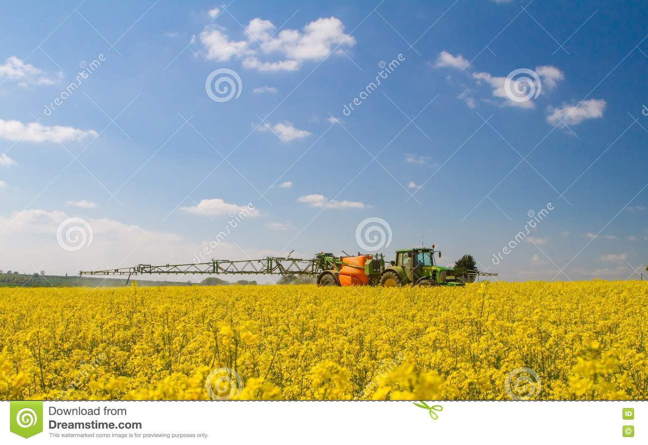 Green Modern Tractor Pulling A Crop Sprayer Editorial Photography