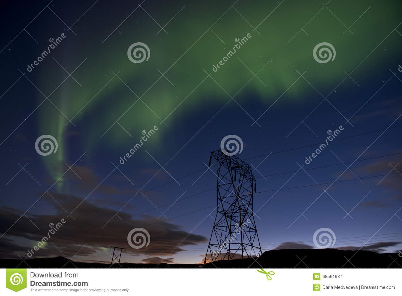 Green Northern lights on a blue night sky with stars, Aurora borealis in Iceland