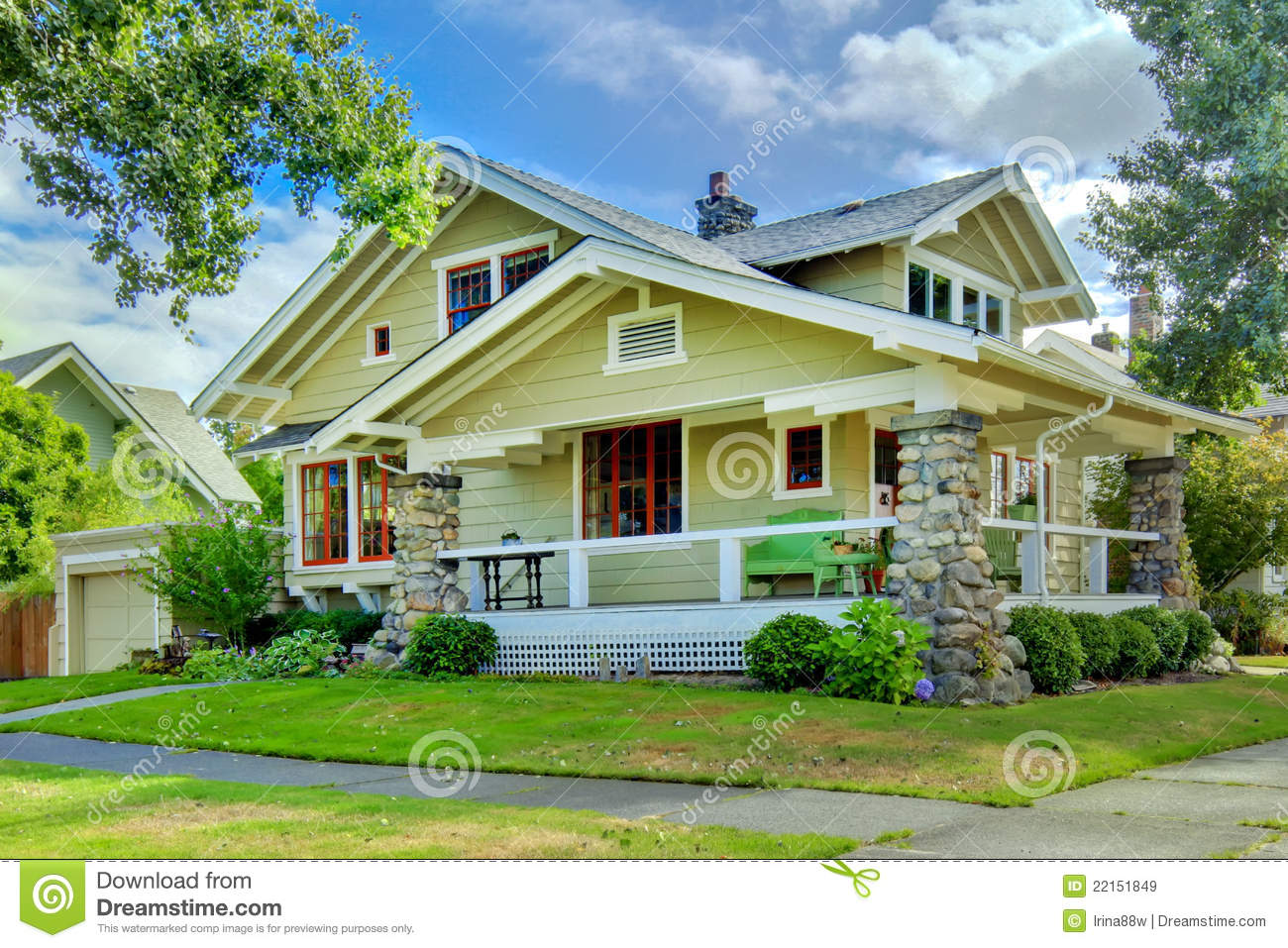 Green old craftsman style home with covered porch stock for Home and style