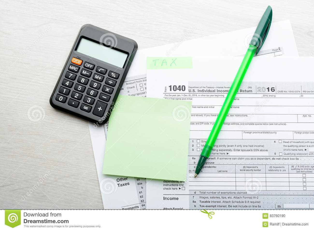 Green Pen And Calculator On Tax Form Editorial Image - Image