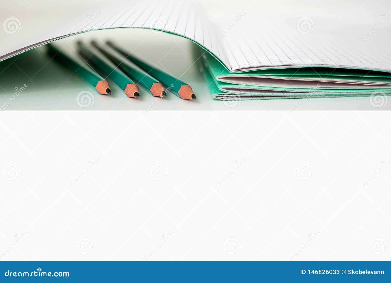Pencils next to the school notebook