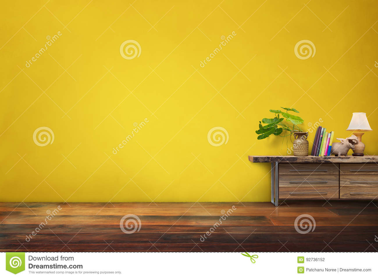 green plants pottery vase on drawer wooden in empty yellow vintage living room interior
