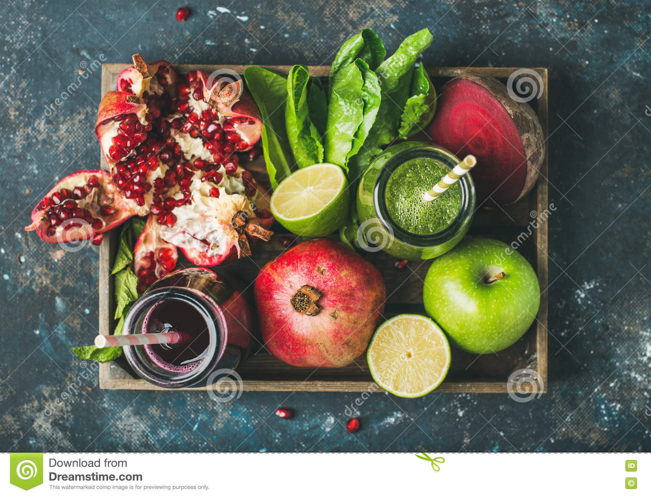 Green, purple fresh juices with fruit, greens, vegetables in tray