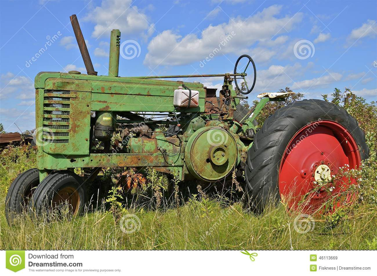 Up The Tractor Green Tractor With Bucket Cartoon : Big old green junkyard tractor stock photography