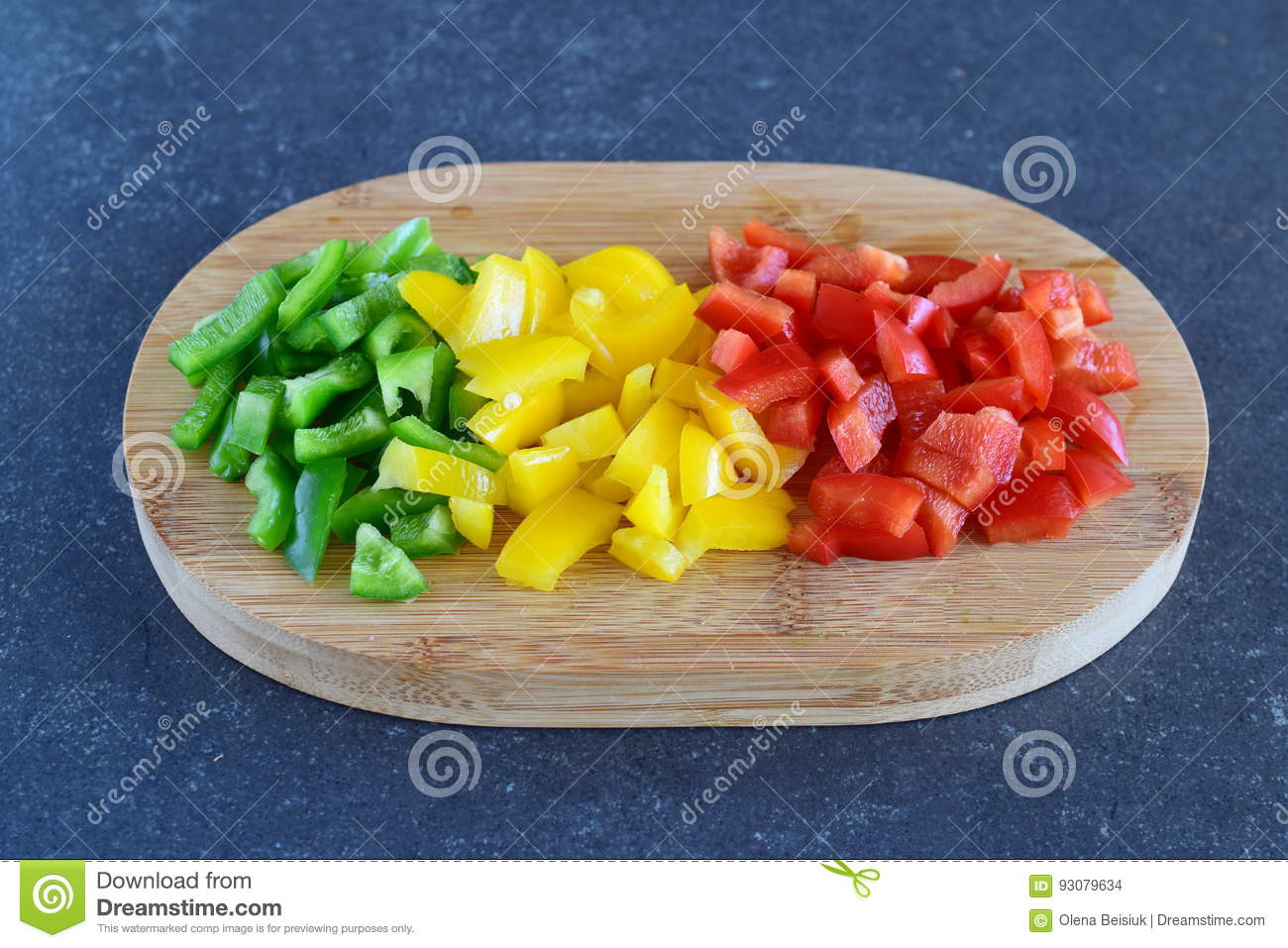 Download Green, Red And Yellow Sweet Paprika Cut In Cubes On A Wooden Cutting Board On A Dark Abstract Background. Step By Step Stock Photo - Image of group, bright: 93079634