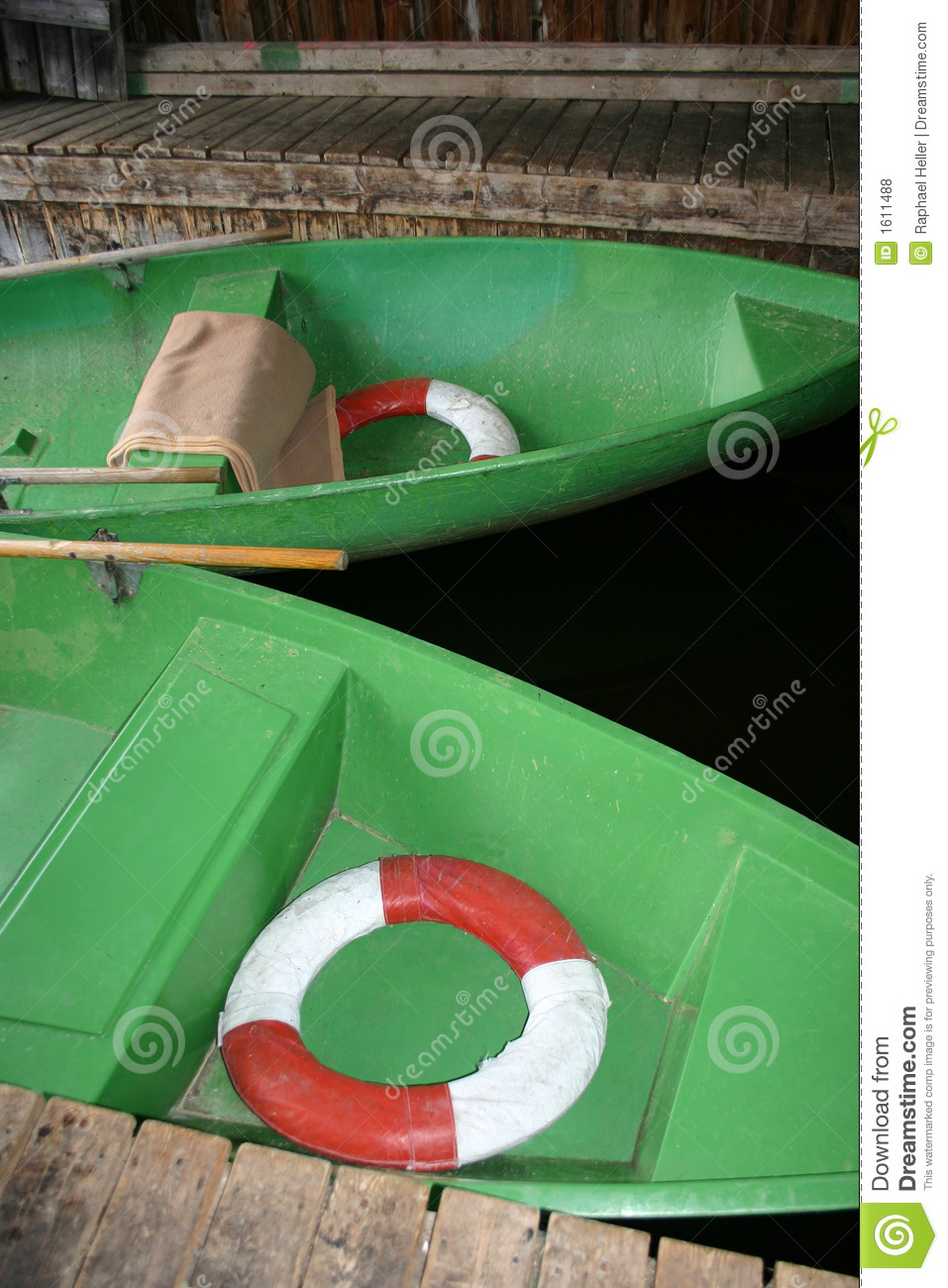 Green rowing boats