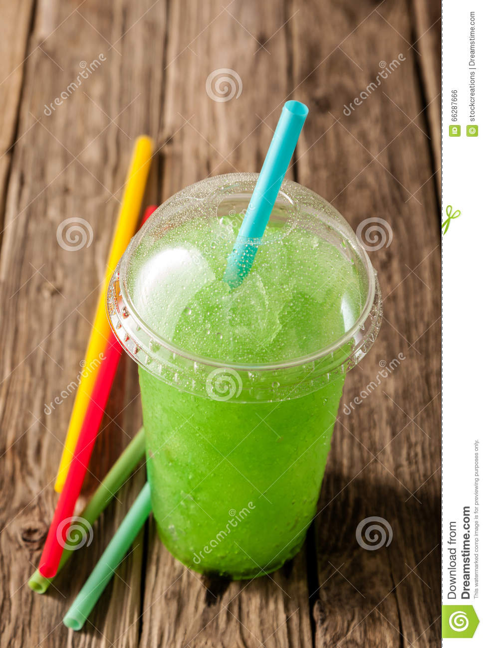 Green Slushie Drink In Plastic Cup With Straws Stock Photo