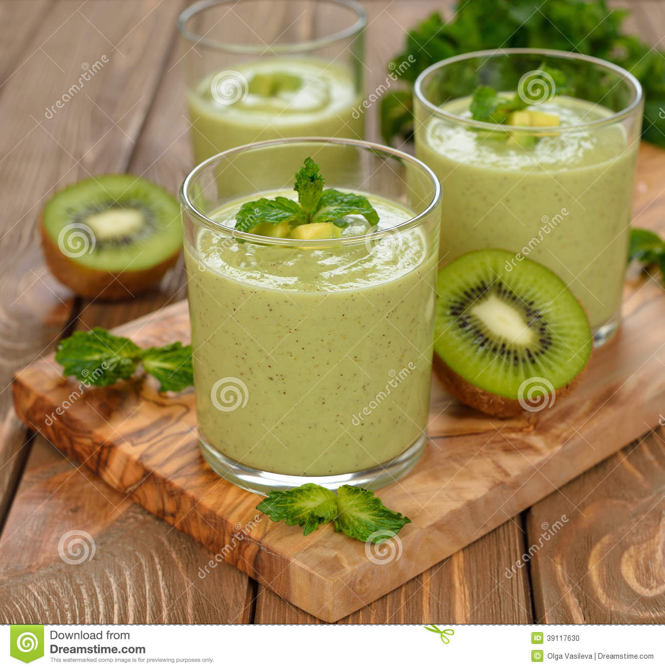 Green Smoothies In Small Bottles To Go Stock Photo