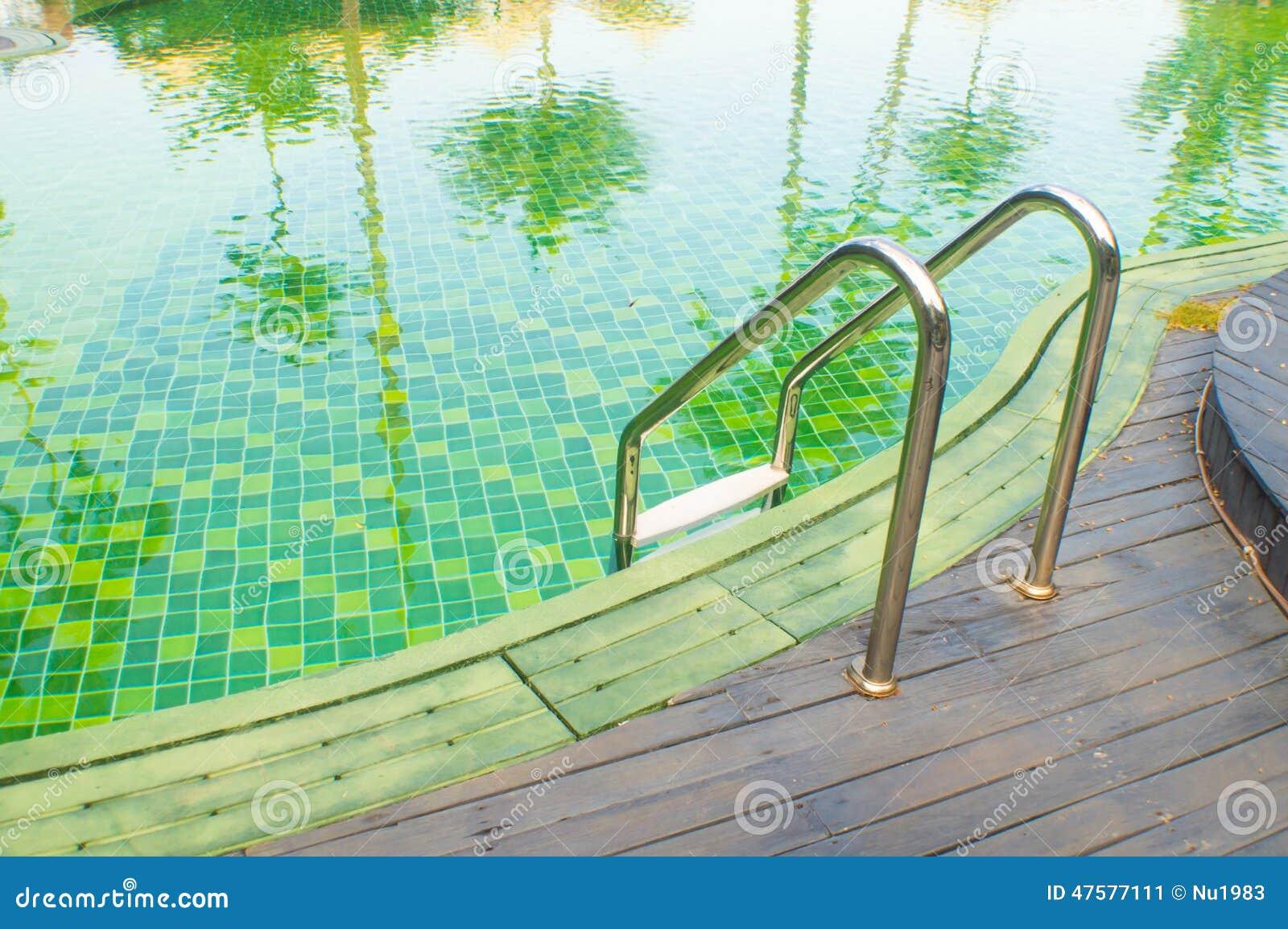 Green swimming pool with teak wood flooring stock photo - White oak swimming pool opening times ...