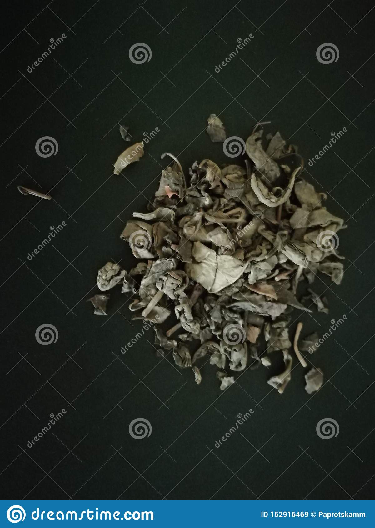 Green tea in black background . Copy space