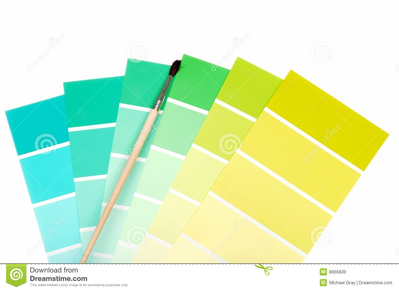 green to blue color chips with paint brush stock image