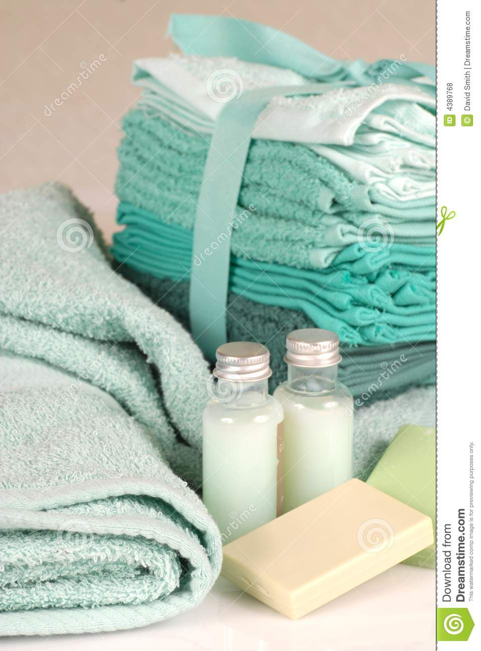 Green towels with soap and shampoo