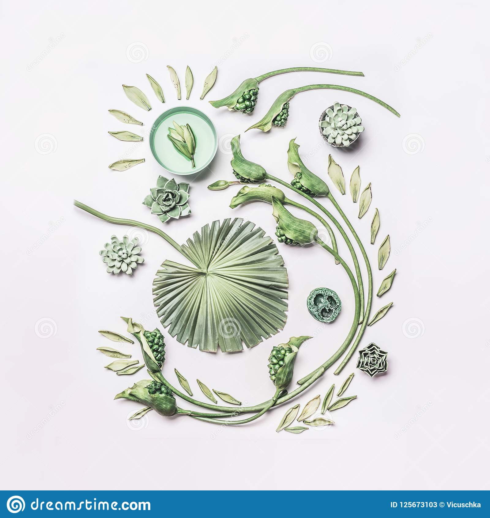 Green tropical leaves and curl flowers composition with water bowl on white background, top view, flat lay. Spa and wellness, conc