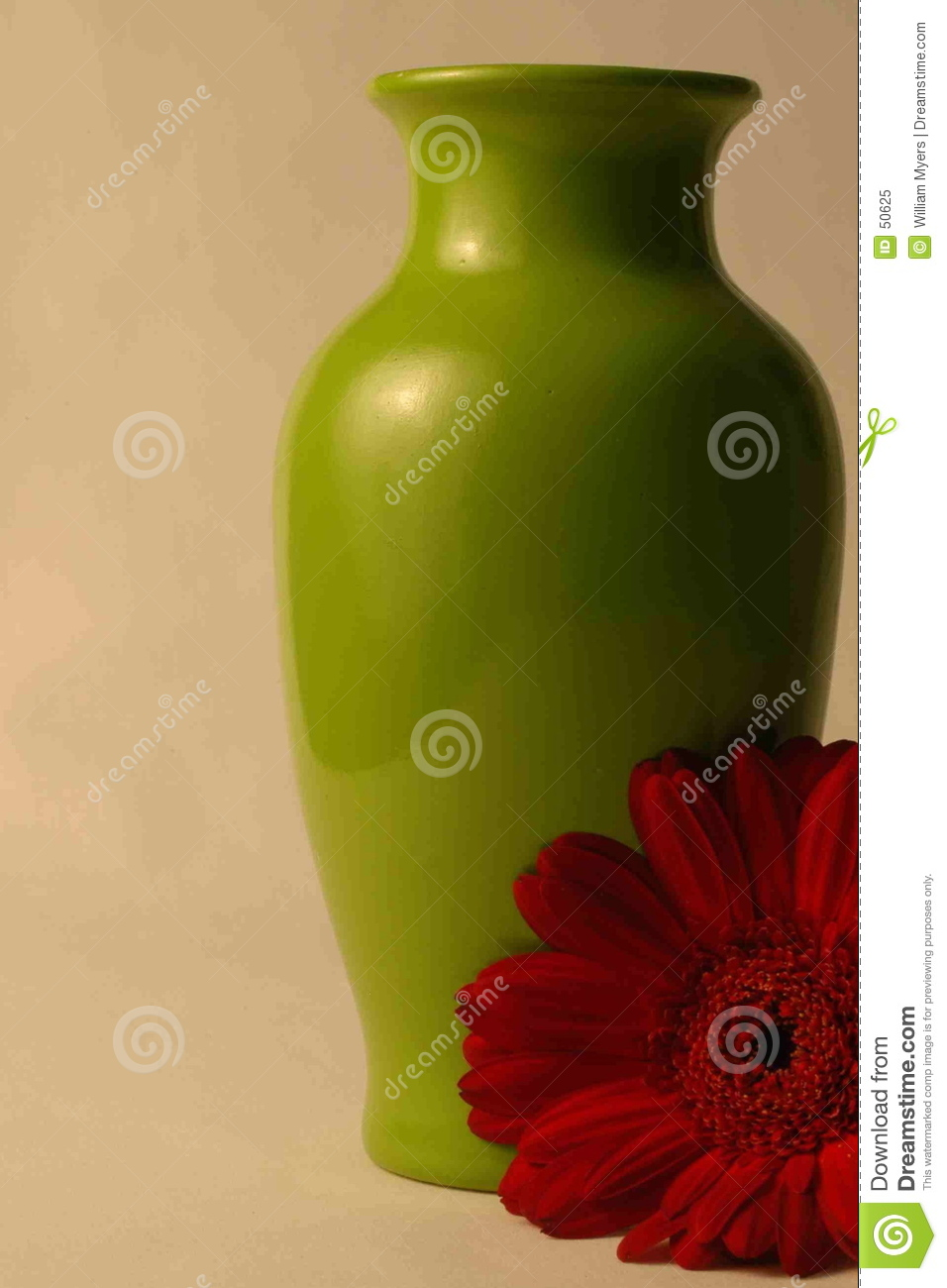Green vase with red daisy