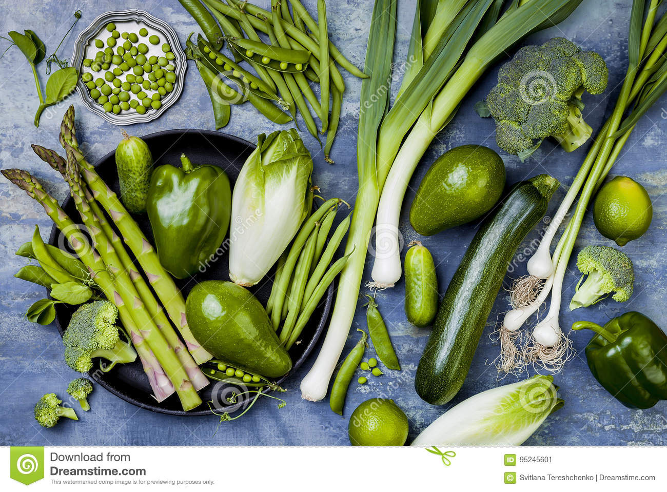 Green veggies group. Vegetarian dinner ingredients. Green vegetables variety. Overhead, flat lay, top view.