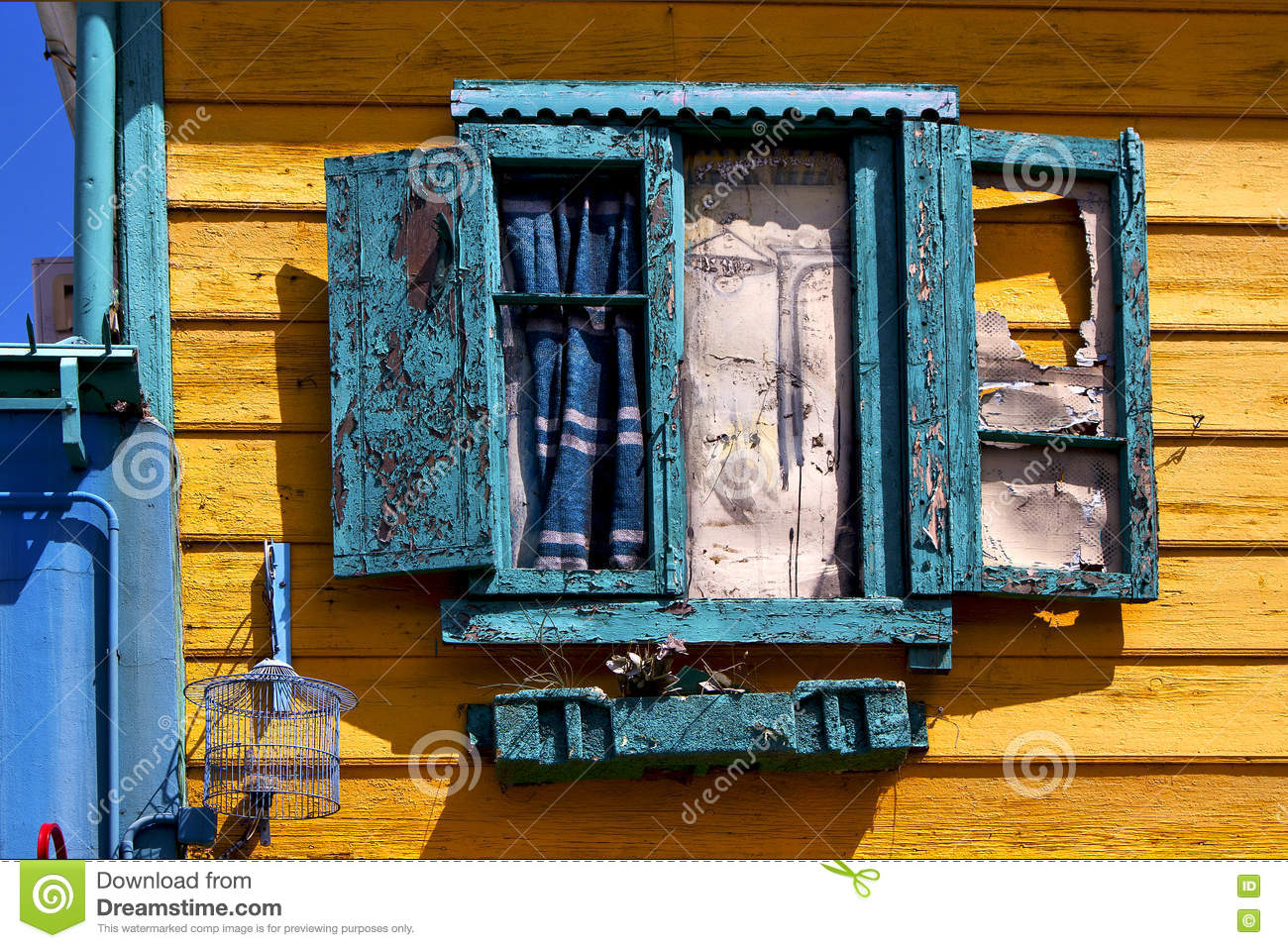 green venetian blind and a yellow wall la boca buenos aires a