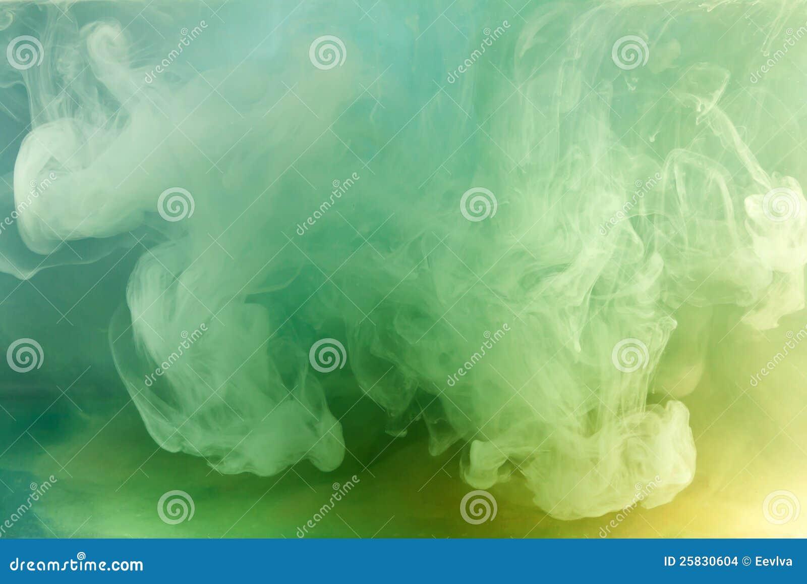 Green watercolor in water.