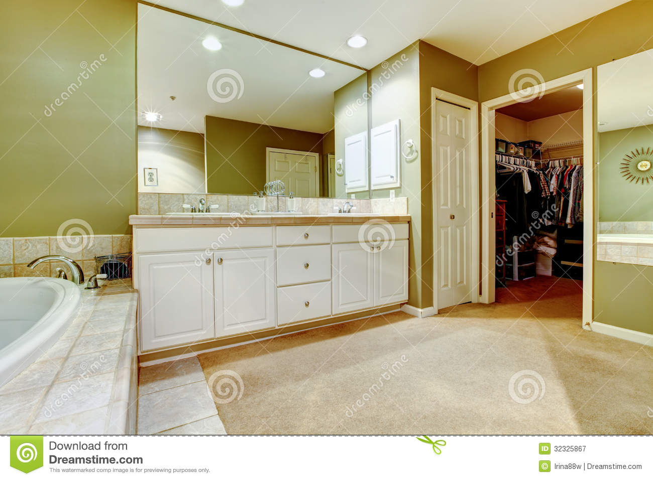 Green and white bathroom with two sinks and closet for Green and white bathroom